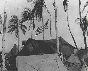 American Flag flies over beach camp on Taclaban in the Southwest Pacific in WWII - signal corps photo